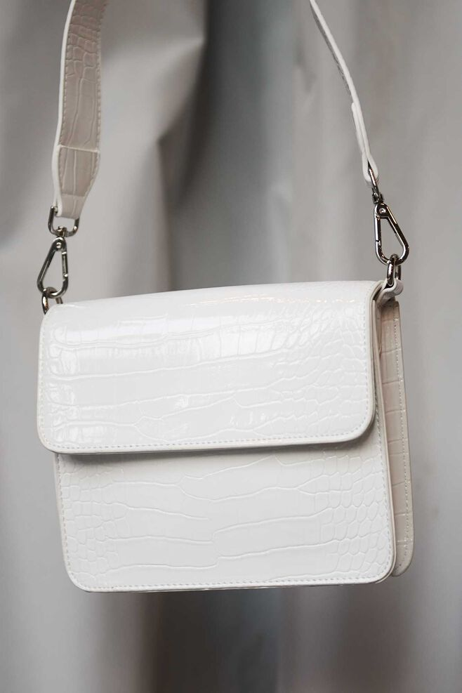Cayman shiny strap bag H1021